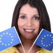 Woman holding up European Union flags — Stock Photo