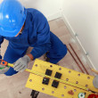 Top-view of plumber measuring copper pipe — Stock Photo #9323053