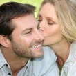 Woman kissing man — Foto Stock