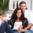 Couple on white sofa — Stock Photo