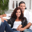 Couple on white sofa — Stock Photo #9323415