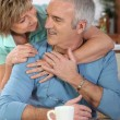 Stock Photo: Mature couple having breakfast