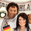 Happy german soccer supporters - Stock Photo