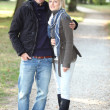 Couple walking in the park — Stock Photo