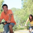 Couple cycling in the countryside — Stock Photo #9323864