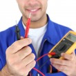 Electrician displaying voltmeter — Stock Photo #9324669