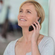 Happy woman talking on her mobile phone — Stock Photo