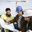 Construction team looking at plans — Stock Photo #9325072