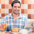 Young breakfast with magazine — Stock Photo