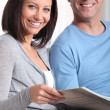 Couple looking at a photo album — Stock Photo #9325582
