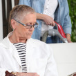Stock Photo: Helping senior woman on household chores