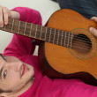 Man playing acoustic guitar — Stock Photo #9325696