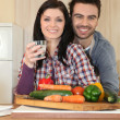 Couple in the kitchen - Stock Photo