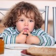 Child looking plate of pancakes — Stock Photo