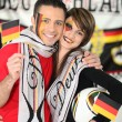 Stock Photo: Young couple supporting Germnational team