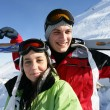 Couple stood on mountain with skis — Stock Photo #9326251