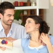 Man Woman receiving gift — Stock Photo