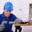 Stock Photo: Craftsmassembling pipes