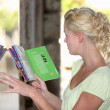 Woman with book outdoors — Stock Photo