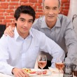 Two men in a restaurant — Stock Photo