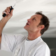 Painter repainting ceiling — Stock Photo #9327135