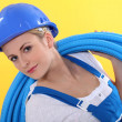 Stock Photo: Blond plumber carrying plastic piping
