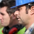 Foreman chatting to colleague — Stock Photo