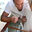 Father and son with a fishing net - Stock Photo