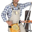 Foto de Stock  : Carpenter wearing toolbelt