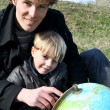 Father and son looking at a globe — Stock Photo #9327506