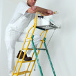 Painter climbing ladder to paint ceiling — Stock Photo #9328193