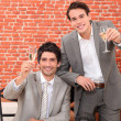 Two young businessmen celebrating successful year — Stock Photo