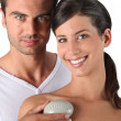 Couple holding a bar of soap - Stock Photo