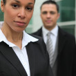 Young business couple stood in front of their office — Stock Photo #9328791