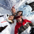 Stock Photo: Friends playing in the snow