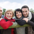 Stock Photo: Family stood by fence