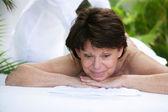 Mature woman having a massage — Stock Photo