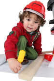 Little boy playing with a toy workshop — Stock Photo