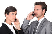 Business man and woman using cellphones — Stock Photo