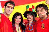 Group of soccer fans backing the Spanish team — Stock Photo