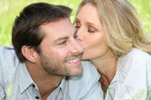 Woman kissing man — Stock Photo