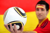 Football supporter holding soccer ball — Stock Photo