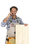 Woodworker standing with mobile phone — Stock Photo