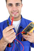 Electrician displaying voltmeter — Stock Photo