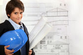 Child imitating architect — Stock Photo