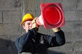 Man looking through construction beacon — Stock Photo