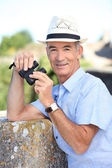Senior man with a pair of binoculars — Stock Photo