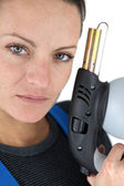 Woman holding a blowtorch — Stock Photo