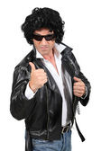 Ironic rocker in a wig and leather jacket — Stock Photo