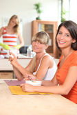 Girls in the kitchen eating breakfast — Stock Photo